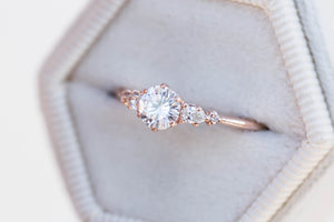 Moissanite and diamond five stone engagement ring