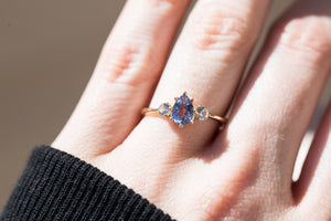 Periwinkle pear sapphire three stone ring