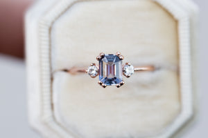 Emerald cut purple ceylon sapphire three stone ring