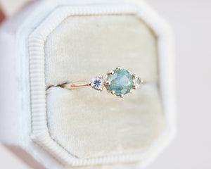 Montana sapphire three stone ring, pastel 8 prong center