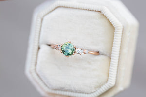 Round green sapphire and diamond cluster five stone ring