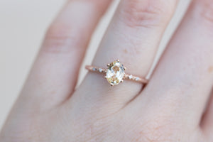 Butter yellow oval sapphire floral engagement ring