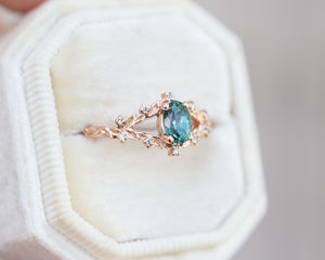 Briar rose setting with teal Montana sapphire