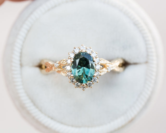 Teal sapphire halo leaf engagement ring