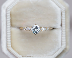 Moissanite and marquise diamond five stone engagement ring