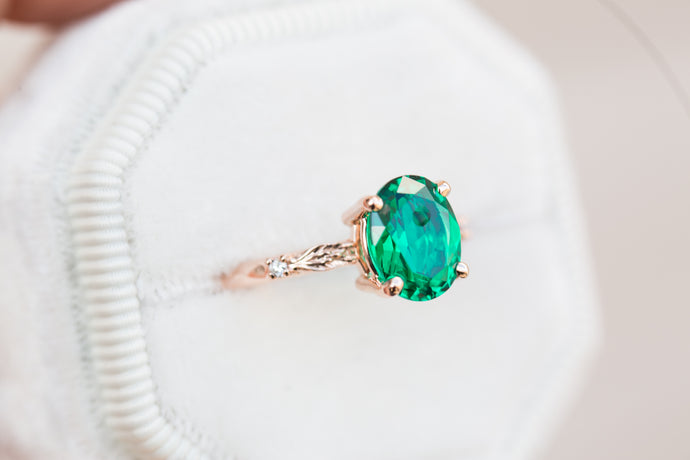 Oval lab emerald leaf engagement ring