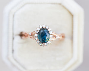 1.25ct deep teal twisted leaf halo ring