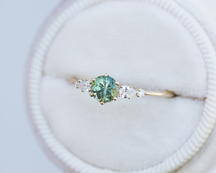 Round green sapphire five stone ring, pear diamond
