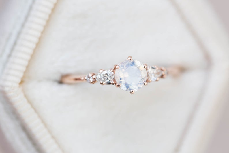 Round moonstone and diamond five stone ring