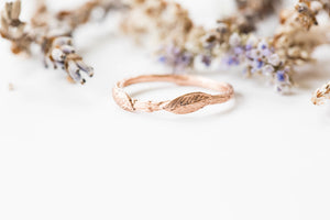 14k gold curved leaf twig wedding band