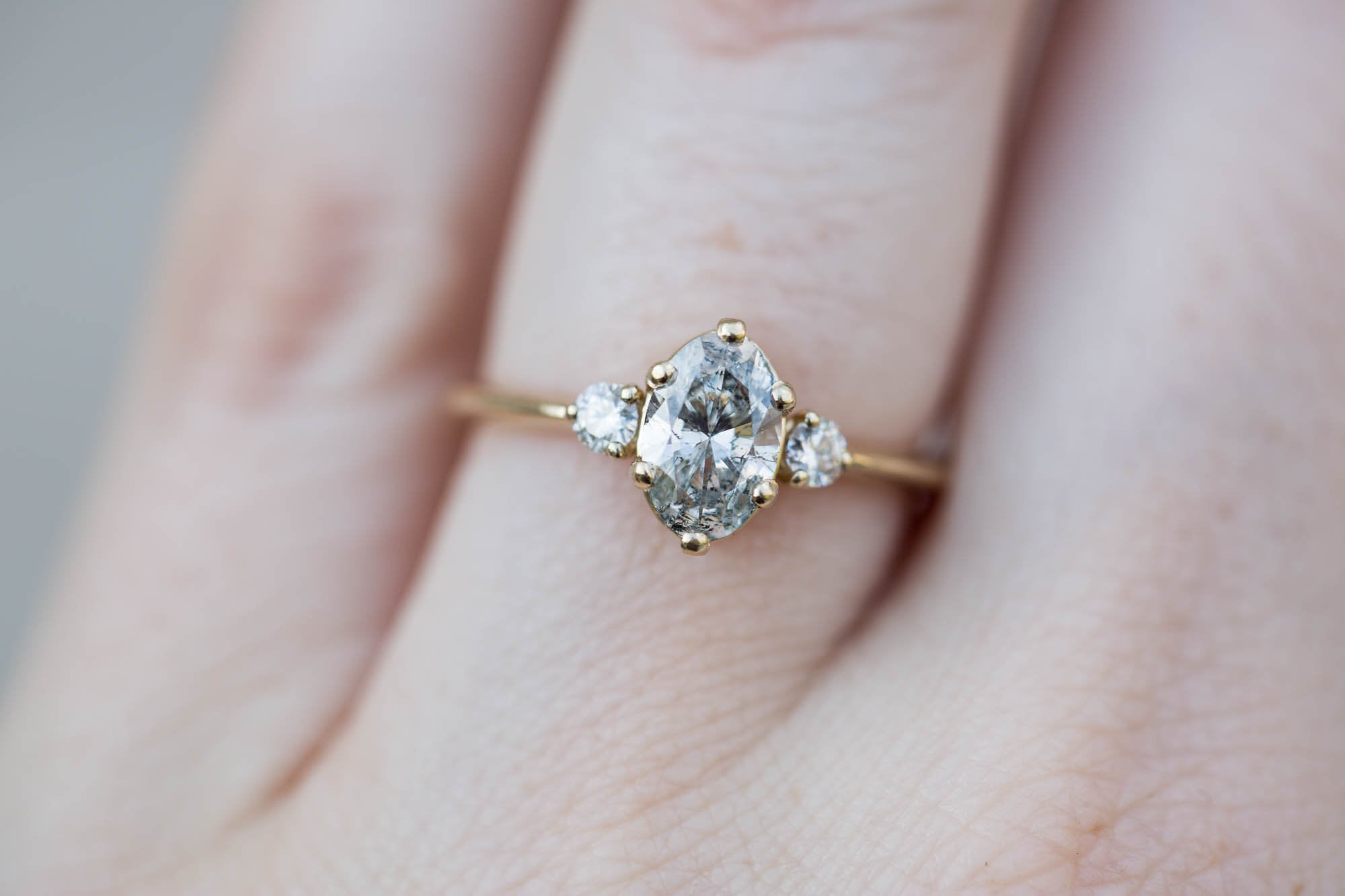 Elongated oval salt and pepper diamond engagement ring