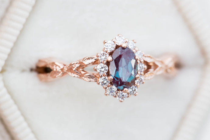 Oval alexandrite halo twisted leaf ring