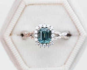 Teal sapphire emerald cut ring, diamond halo ring, leaf engagement ring, nature engagement ring, blue green sapphire ring, twisted band