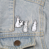 funny enamel pins on denim jacket
