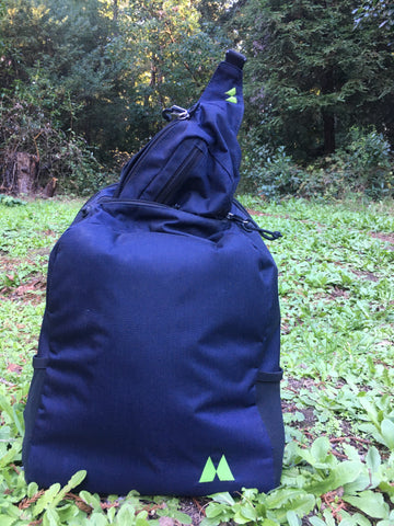 hip pack sticking out of day pack top