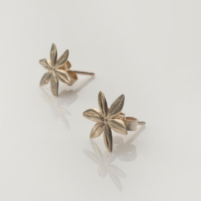 Cover me in daisies tiny stud earrings in solid gold