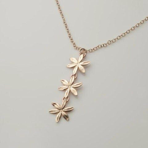 9ct gold necklace with 3 flowers by deblaca jewellery made in Ireland