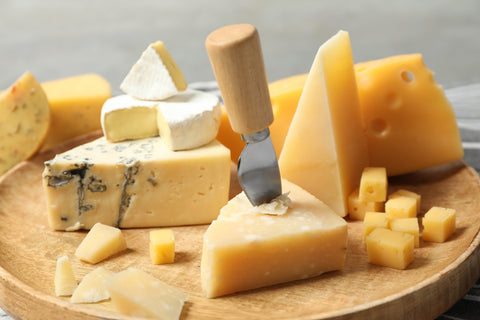 Cheese board with cubes and wedges of cheese