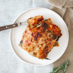Baked cheese on top of fresh spring vegetable lasagne - Lavish Cheese