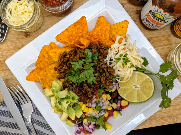 Taco salad with grated cheese - Lavish Cheese