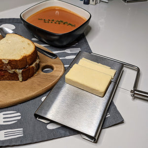 Countertop Wire Cheese Slicer with cheddar cheese sliced - Lavish Cheese
