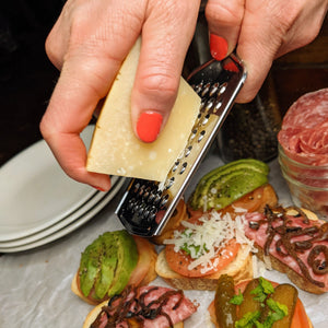 Mini Parmesan Cheese Grater being used to put cheese on canapes - Lavish Cheese