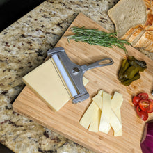 Load image into Gallery viewer, Adjustable Wire Cheese Slicer with sliced cheese on a wood board - Lavish Cheese