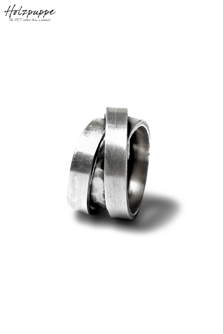 Holzpuppe Triple banded silver ring with unique texture
