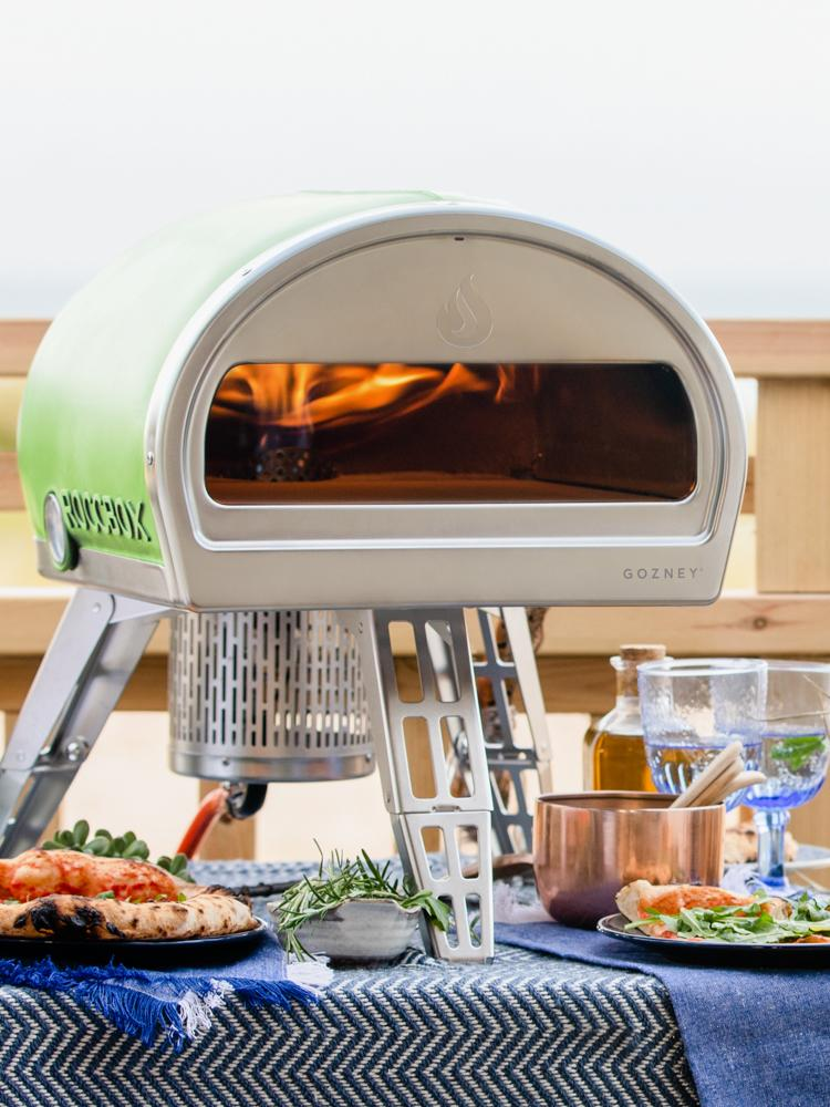Portable pizza oven on the beach
