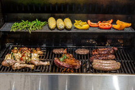 Full grill full of meat and veggies