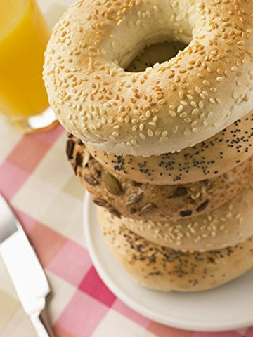 Wallmonkeys FOT-8267830-30 WM210743 Stack of Seeded Bagels with a Glass of Orange Juice Peel and Stick Wall Decals (30 in H x 23 in W), Medium-Large