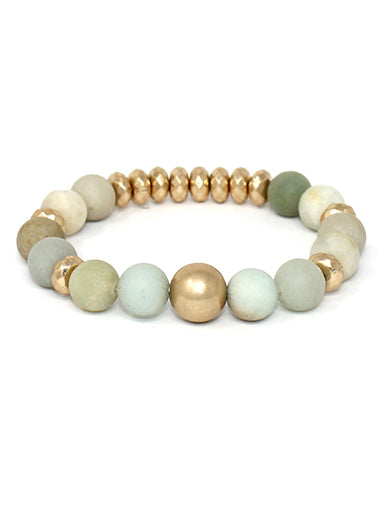 A Blonde and Her Bag Green, blue, and gold multi ball soap stone stretch bracelet.
