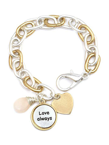 A Blonde and Her Bag Gold and silver chain charm bracelet with wire wrapped rose quartz and