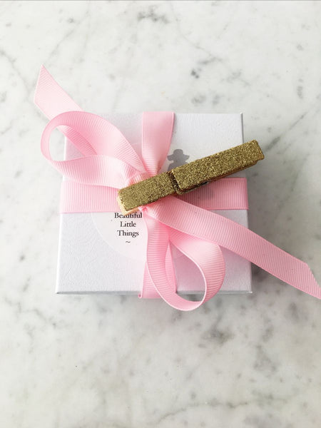 Gift Wrap Boxes with Pink Ribbon and Glitter Clothespin