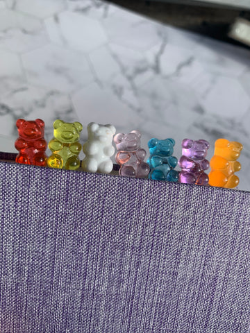 Red, yellow, white, pink, blue, purple and orange color gummy bear paper clips
