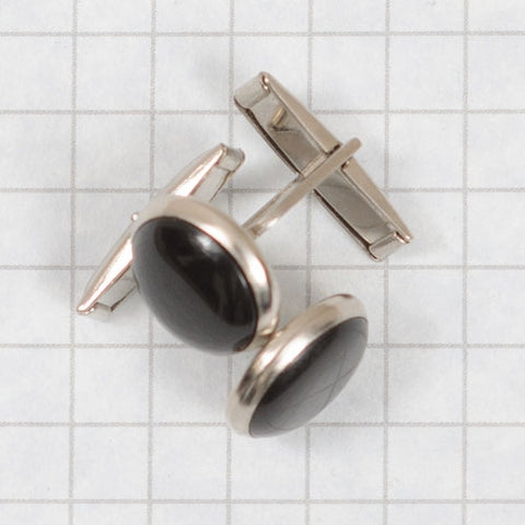 cuff links, round -black with silver rims (sold by the piece)