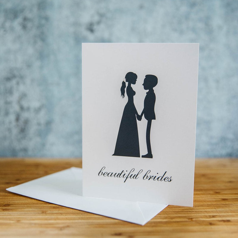 Black Silhouette of Two Beautiful Brides - One in Dress and One in Suit with Short Hair  - White Background - LGBTQ+ Greeting Card