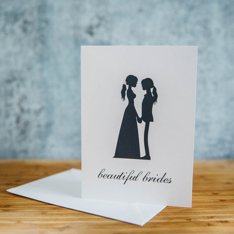 Black Silhouette of Two Beautiful Brides - One in Dress and One in Suit with Long Hair  - White Background - LGBTQ+ Greeting Card