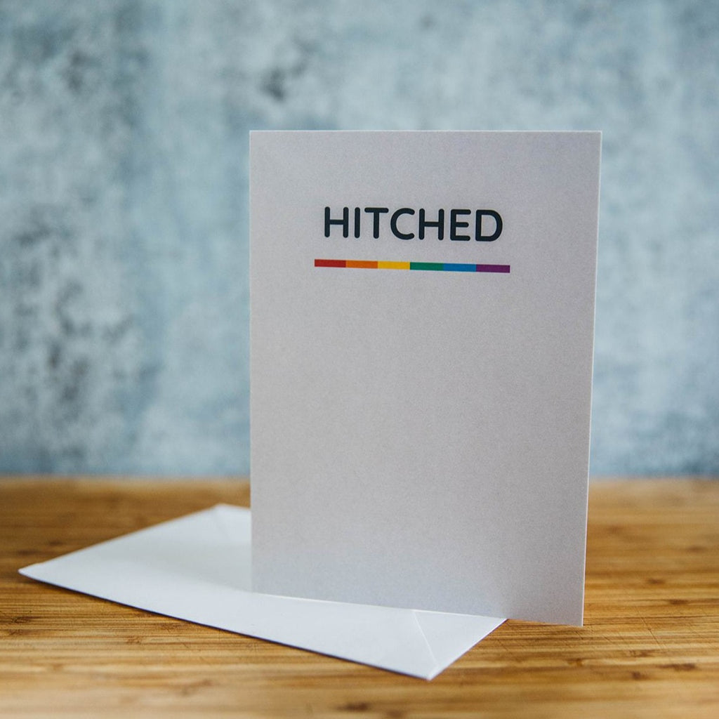 Hitched with Rainbow line on white LGBT Wedding Greeting Card