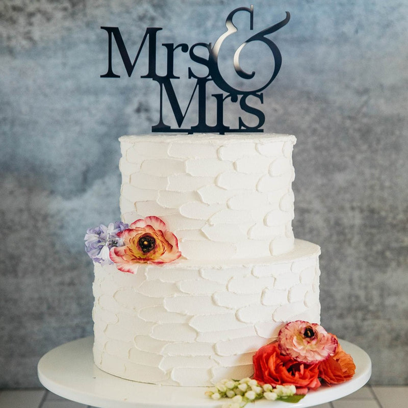 Lesbian Women's Mrs & Mrs Black Wedding Cake Topper On Top of White Cake