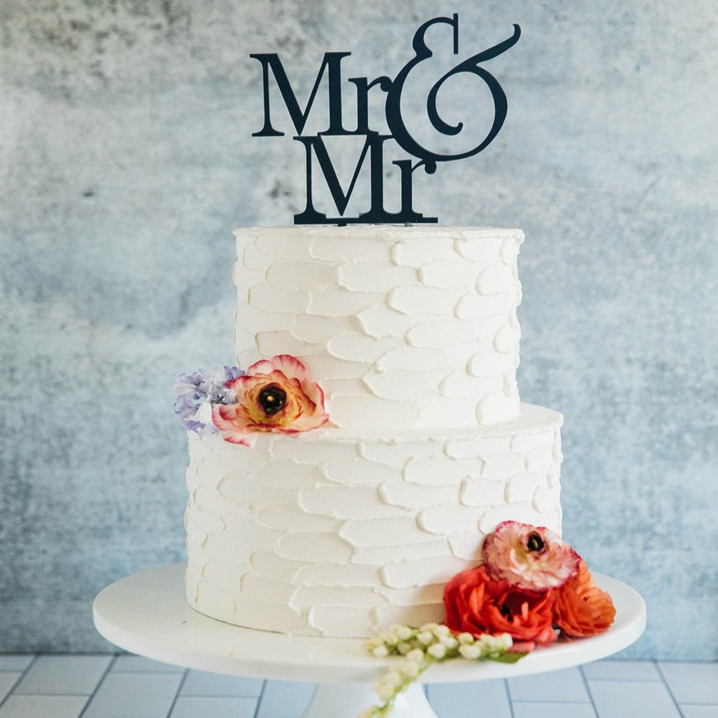 Gay Men's Mr & Mr Black Wedding Cake Topper On Top of White Cake