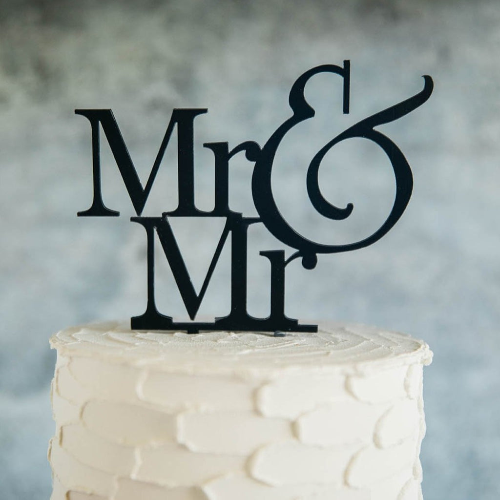 Gay Men's Mr & Mr Black Wedding Cake Topper On Top of White Cake - Close Up