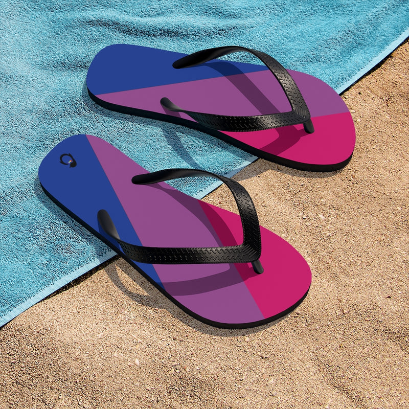 Bi-sexual Pride Flip-Flops - Black Straps - Blue Purple Pink Soles - On Beach Towel and Sand