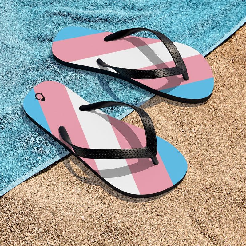 Transgender Pride Flip-Flops - Black Straps - Blue Pink White Soles - On Beach Towel and Sand