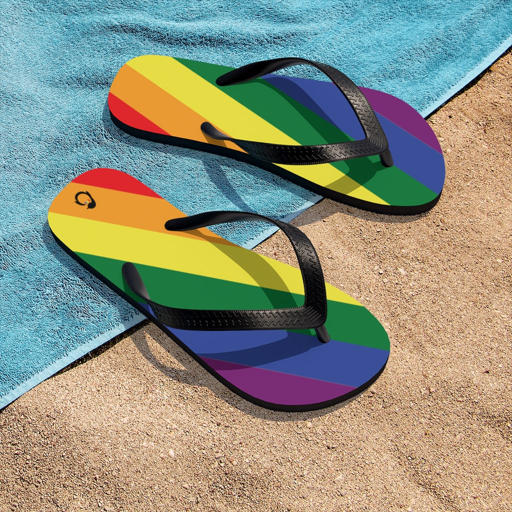 LGBTQ+ Rainbow Pride Flip-Flops - Black Straps - Rainbow Soles - On Beach Towel and Sand