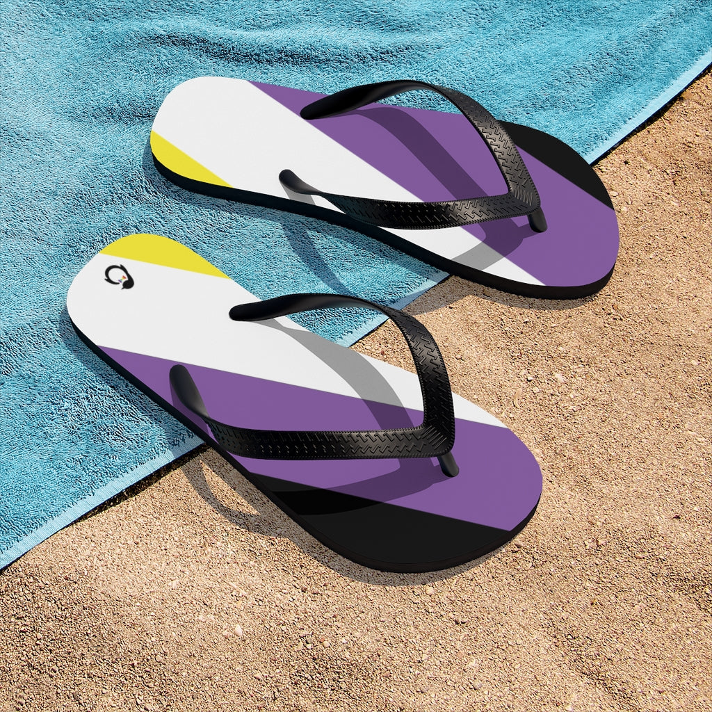 Non-Binary Pride Flip-Flops - Black Straps - Yellow White Purple Black Soles - On Beach Towel and Sand