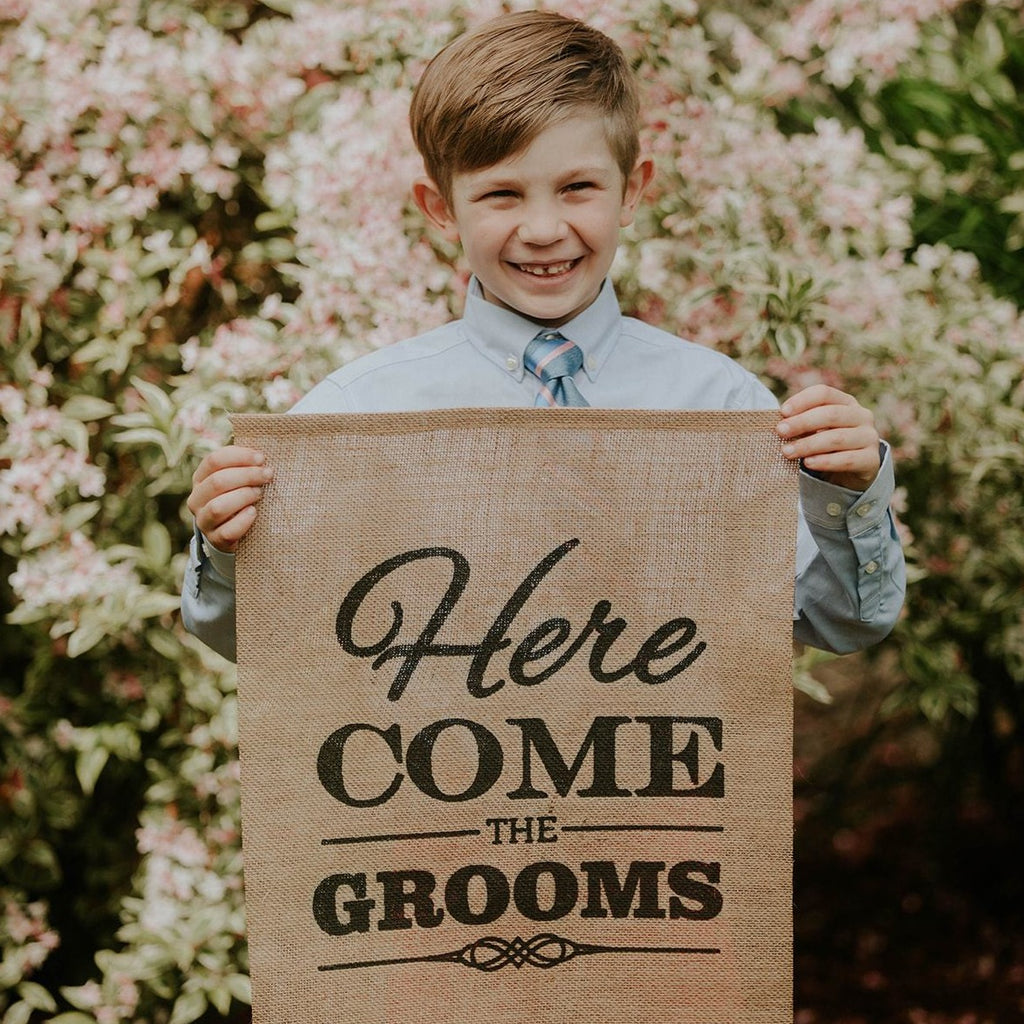 Child Holding Here Come The Grooms Brown Burlap Banner - LGBTQ Wedding Day