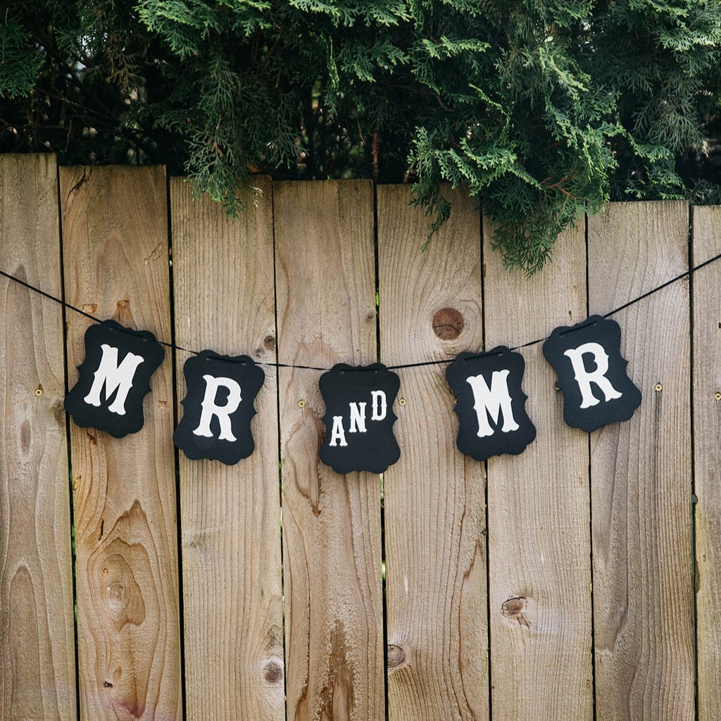 Mr and Mr Black Craft Banner Hanging from Wooden Fence