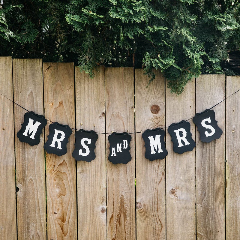 Mrs and Mrs Black Craft Banner Hanging from Wooden Fence