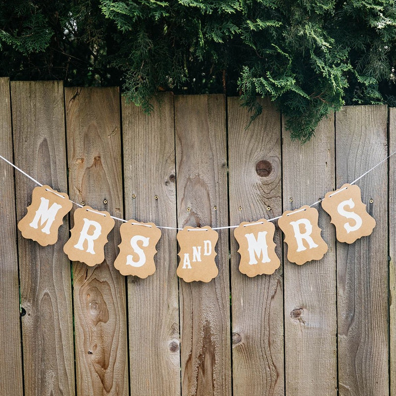 Mrs and Mrs Brown Craft Banner Hanging from Wooden Fence